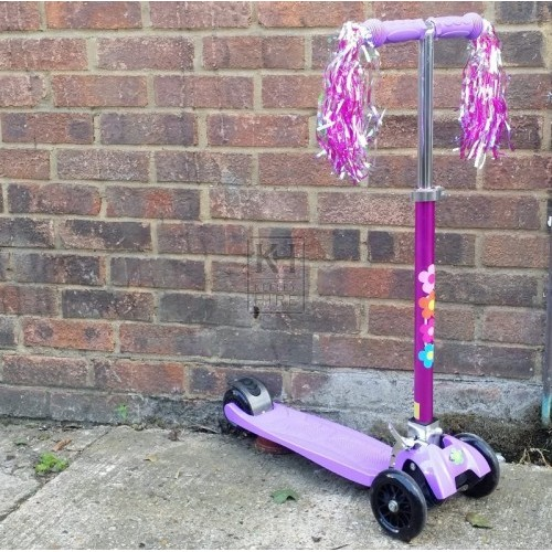 Purple childs scooter with tassles