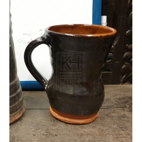 Dark brown pottery tankard