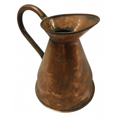 Shaped copper jug with spout