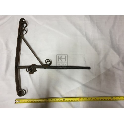 Worn iron bracket with scrolls