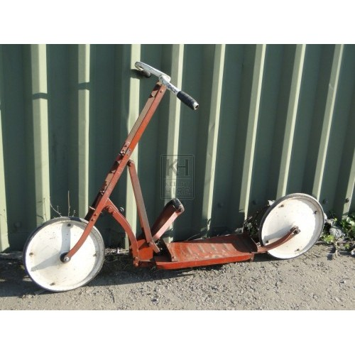 Childs red metal scooter