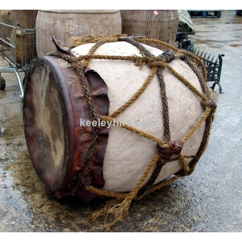 Bulbous urn with rope & leather top