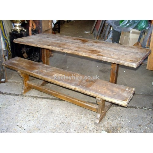 Dark wood table with bench