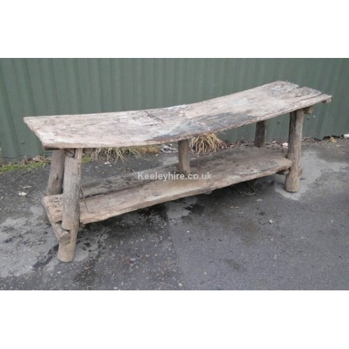 Low wood curved rustic bench