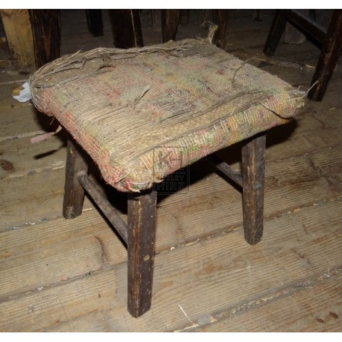 Very tatty upholstered stool