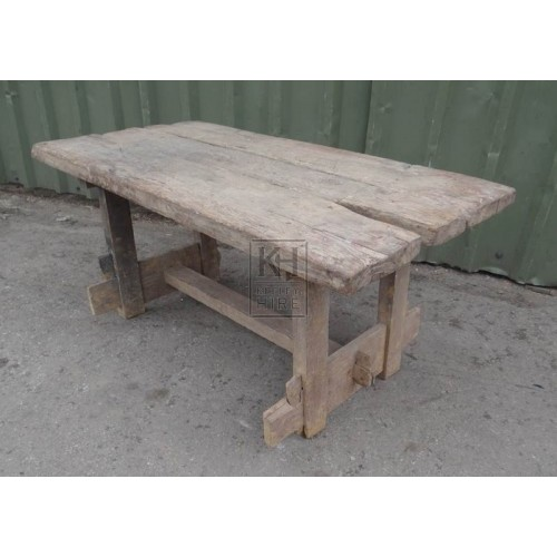 Thick aged wood table with split