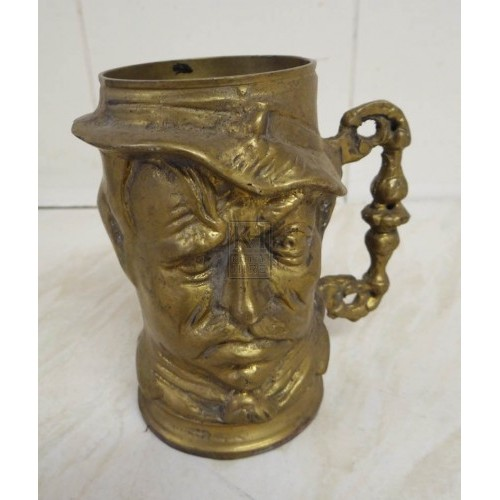 Brass tankard with head