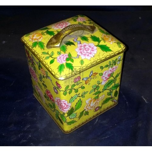 Yellow decorative biscuit tin