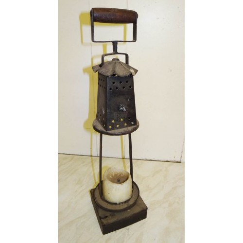Antique iron lantern with wood handle