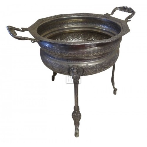 Ornate silver tureen on legs