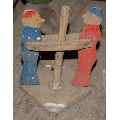 Small Wooden Figures on Stand