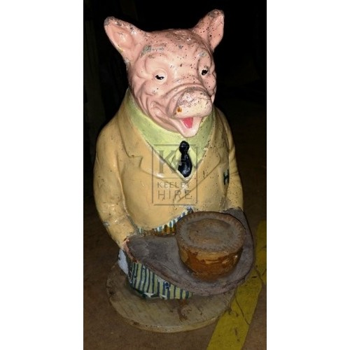 Butchers display pig with jacket