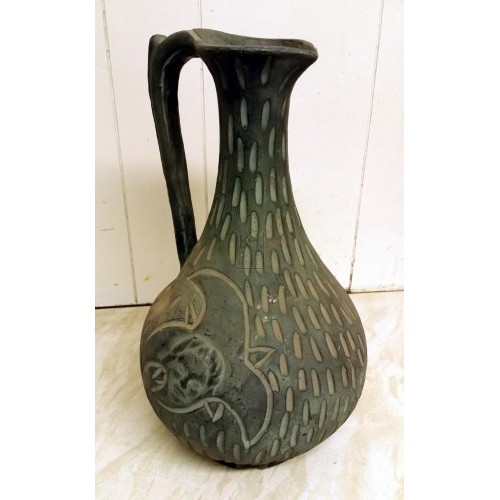 Tall engraved earthenware jug