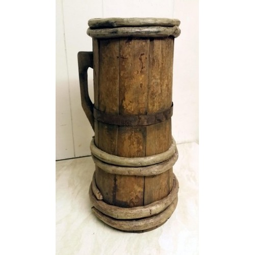 Tall wood jug