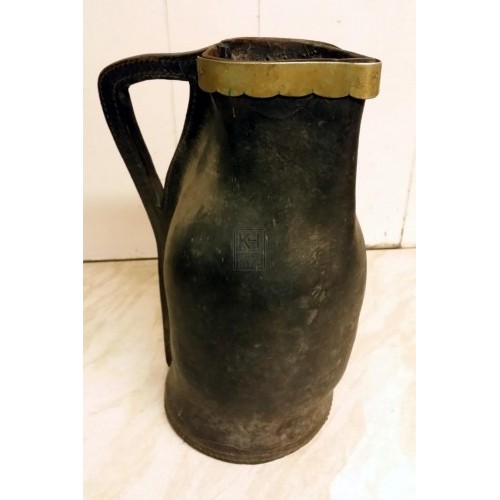 Tall leather jug with brass rim
