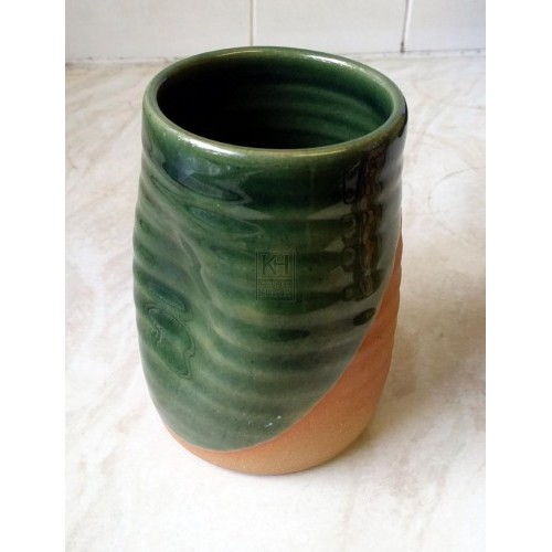 Historic green glazed dell beaker