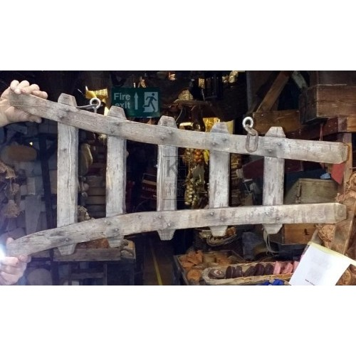 Wood ladder on sign bracket