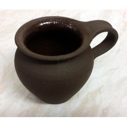 Small dark brown pottery tankard
