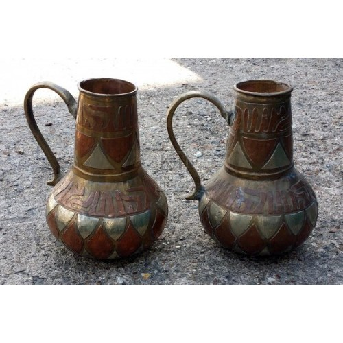 Small ornate brass & copper jugs