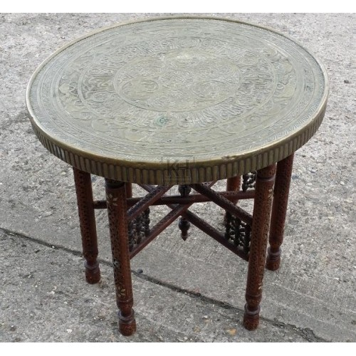 Ornate brass table with wood legs
