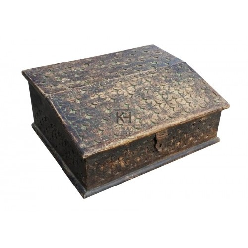 Carved sloped top small chest