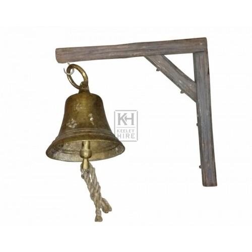 Brass bell on small wood bracket