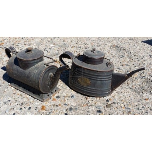 Black shaped metal oil can