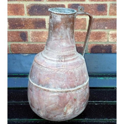 Bulbous beaten copper jug