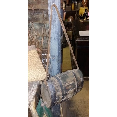 Small wood barrel on strap