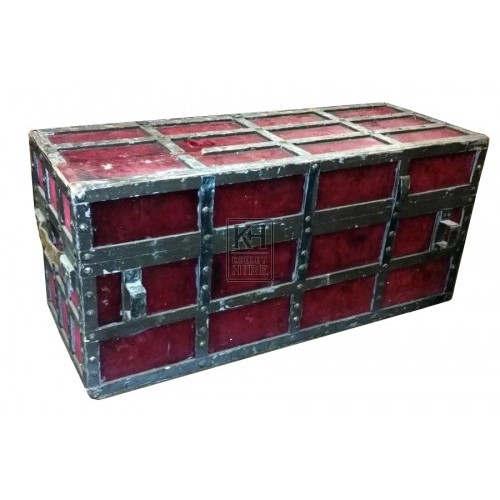 Large red velvet trunk with studs