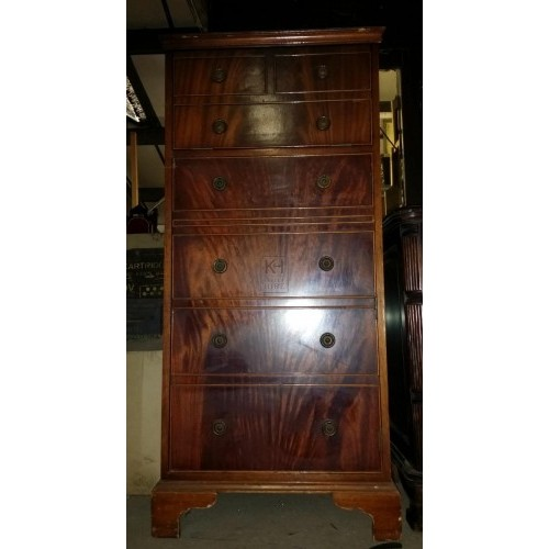 Tall polished cabinet with draws