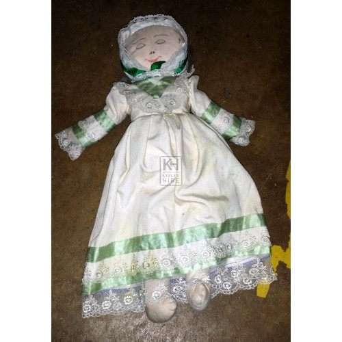 Rag doll with green & white dress