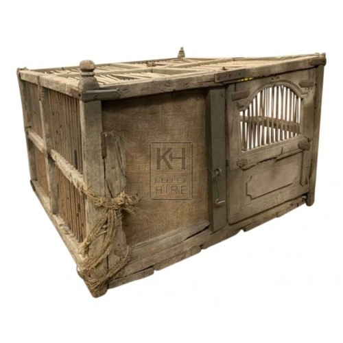 Large aged wood cage with iron bars