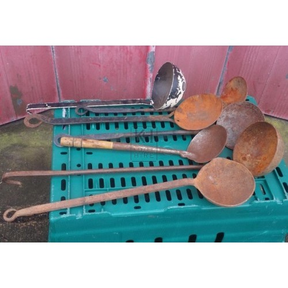 Assorted iron ladles