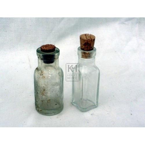 Small clear glass medicine bottle