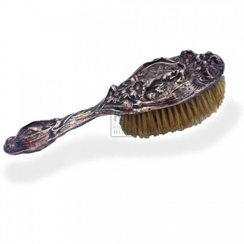 Ornate silver brush