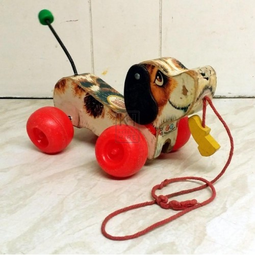 70s toy dog on wheels