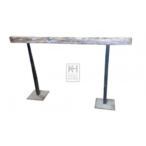 Wood hitching rail with iron posts