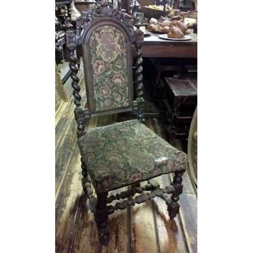 Carved twisted dark wood chair