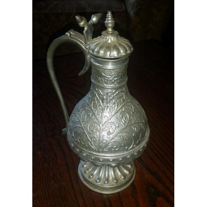 Silver ornate small jug
