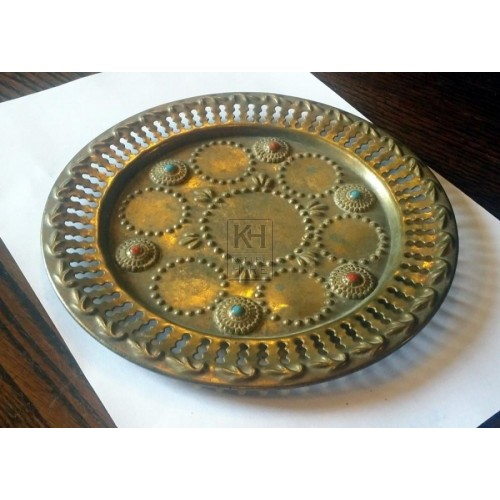 Small brass plate with stones