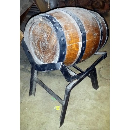 Small light wood barrel on iron stand