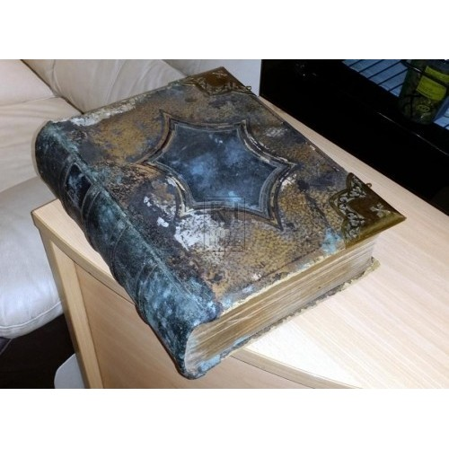 Thick aged leather book