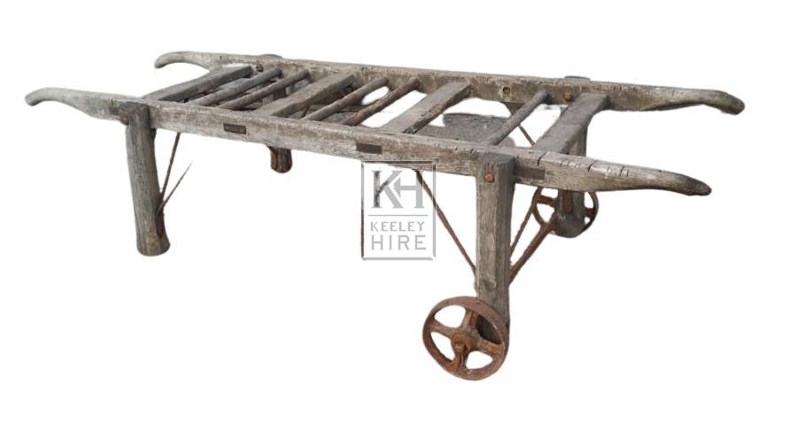 Wood slatted barrow with iron wheels