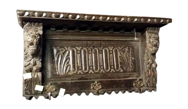 Small polished carved shelf