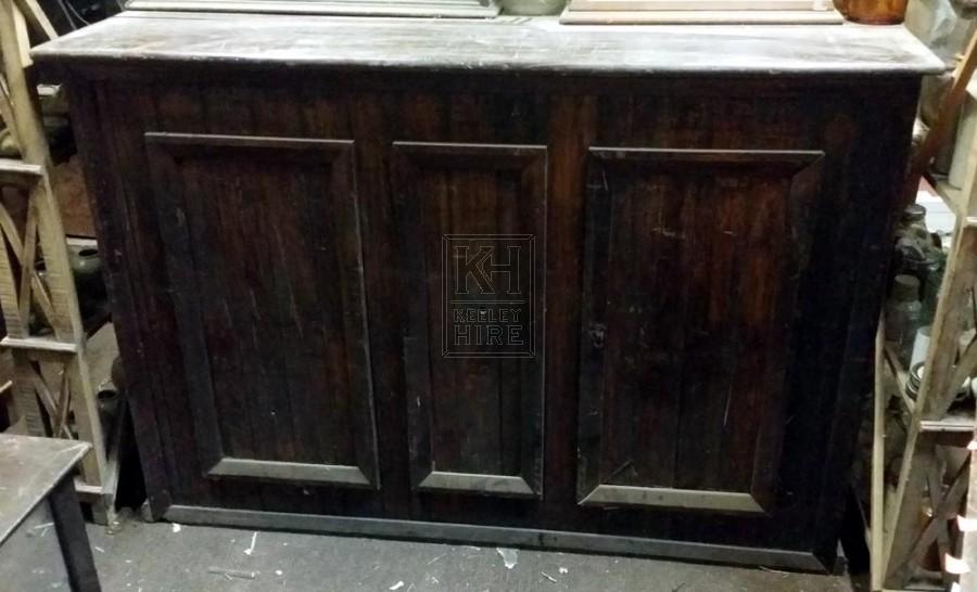 Dark wood shop counter unit