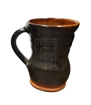 Dark brown pottery tankard