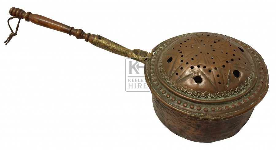 Ornate copper warming pan