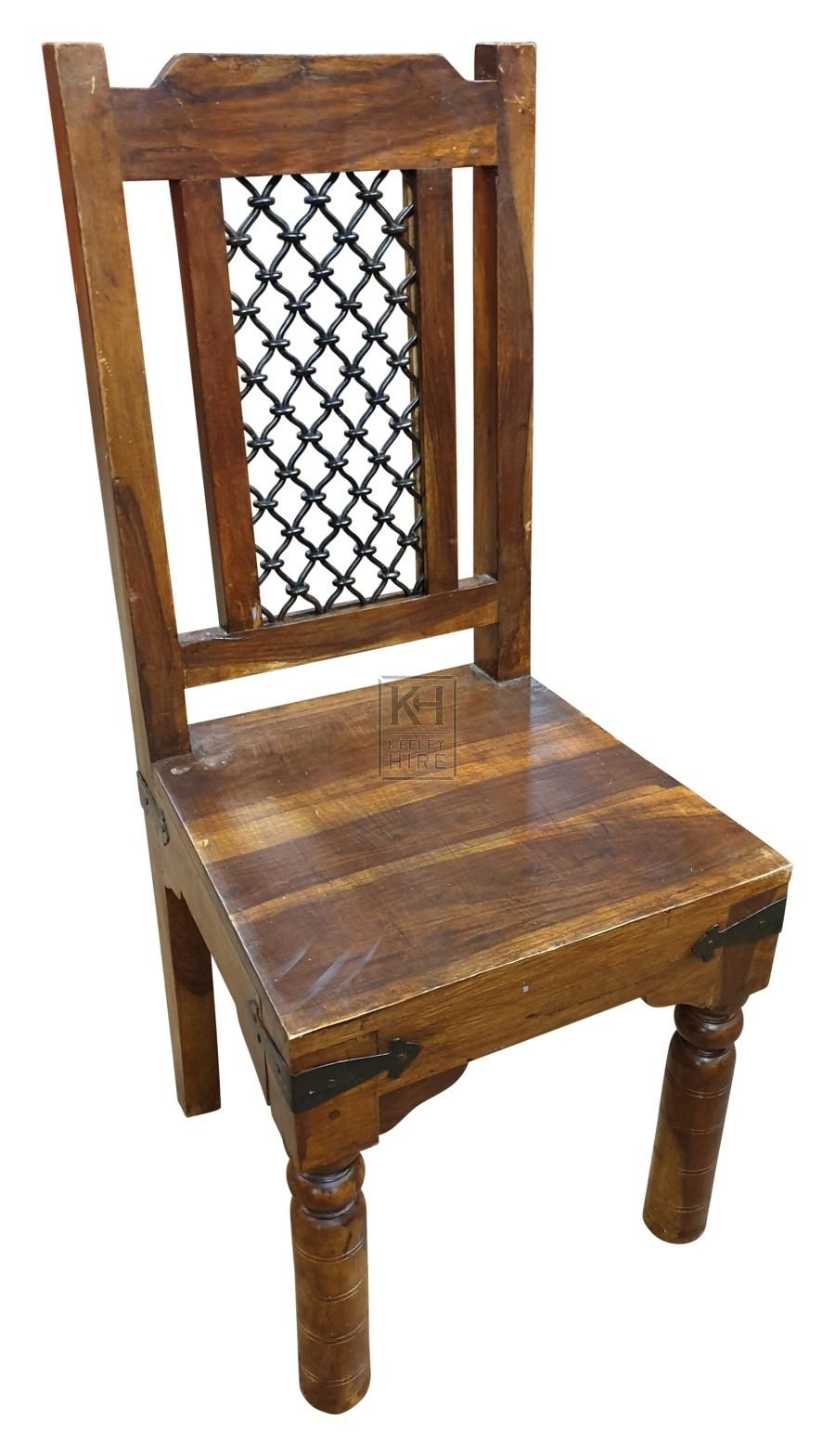 Dark wood high back chair with iron work