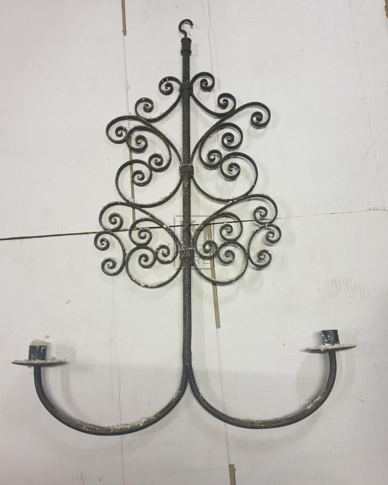 Hanging ornate iron candleholder